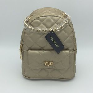 NWT BEBE GOLD ERICA MINI BACKPACK PURSE. PA1
